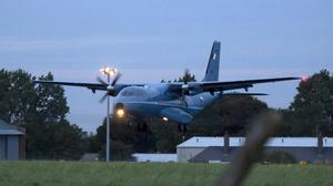 The Air Corps CASA aircraft carrying Gerry Hutch from Spain touches down at Casement Aerodrome