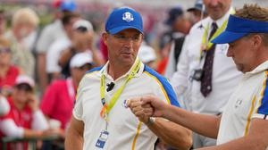 Team Europe captain Pádraig Harrington talks to Ian Poulter during the Ryder Cup singles matches at the Whistling Straits Golf Course