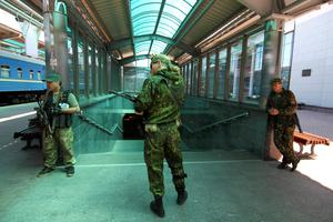 Armed pro-Russian separatists stand guard at a railway station in Donetsk. Reuters