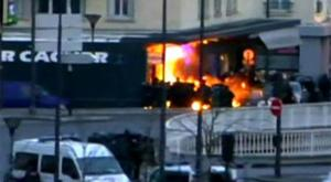 The scene as French special forces stormed the Paris grocery store where a number of hostages were being held