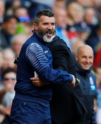 "Aston Villa assistant manager Roy Keane hugs manager Paul Lambert (partially obscured) during their English Premier League soccer match against Newcastle United at Villa Park in Birmingham, central England August 23, 2014. REUTERS/Darren Staples (BRITAIN - Tags: SPORT SOCCER) FOR EDITORIAL USE ONLY. NOT FOR SALE FOR MARKETING OR ADVERTISING CAMPAIGNS. NO USE WITH UNAUTHORIZED AUDIO, VIDEO, DATA, FIXTURE LISTS, CLUB/LEAGUE LOGOS OR ""LIVE"" SERVICES. ONLINE IN-MATCH USE LIMITED TO 45 IMAGES, NO VIDEO EMULATION. NO USE IN BETTING, GAMES OR SINGLE CLUB/LEAGUE/PLAYER PUBLICATIONS"