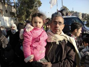 Civilians are evacuated from the besieged Syrian city of Homs during an UN-led operation, on February 9, 2014. Three days of humanitarian access to Homs, parts of which have been under siege for nearly two years, began on January 31 under a UN-mediated deal between the Syrian regime and rebels.