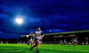 Patrick Curran is chased down by Limerick's Declan Hannon. Photo: Eóin Noonan/Sportsfile