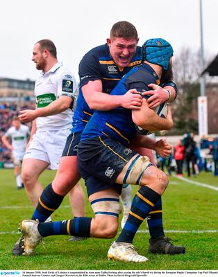 Scott Fardy of Leinster is congratulated by team mate Tadhg Furlong after scoring his side's fourth try