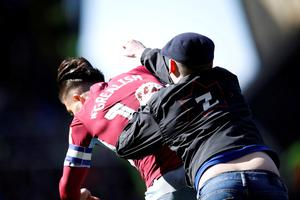 Jack Grealish is struck by a pitch invader early in the first-half. Photo: Action Images via Reuters/Carl Recine