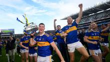 Tipperary captain Séamus Callanan and team-mates celebrate with the Liam MacCarthy Cup
