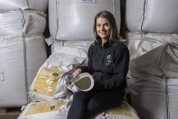 MAKING BIG WAVES:Jennifer with the popular seaweed they sell. Photo: Michael McLaughlin