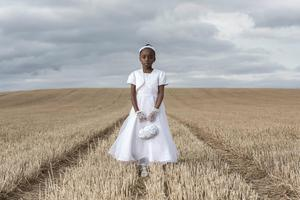 Portrait of a Century features Irish/Nigerian schoolgirl Eunice Adeleye who made her First Holy Communion