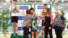 Dean Adams is presented with the Craig Lynch Cup by Craig's mother Anne Lynch and fiancée Amy Cotter after winning the senior men's 60m at the National Senior Indoor Athletics Championships. Photo: Sam Barnes/Sportsfile