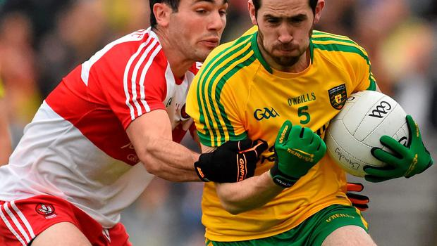 Donegal's Mark McHugh tries to evade Derry's Danny Heavron