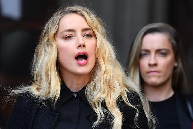 Amber Heard outside the High Court in London (Victoria Jones/PA)
