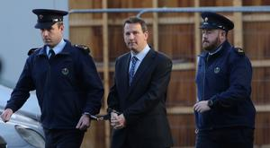 19/12/2013 Graham Dwyer (Center) pictured leaving the Four Courts yesterday(Thurs) after his bail application was refused following a Supreme Court hearing.Pic: Collins Courts
