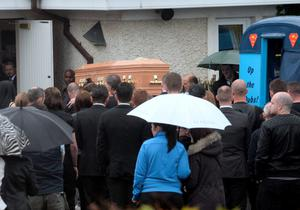 The coffin being carried into church from the Dubs supporters bus. Funeral of Stephen (Steve) Harris, Divine Mercy Church, Balgaddy, Dublin. Picture: Caroline Quinn