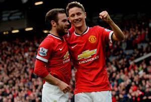 Ander Herrera celebrates with teammate Juan Mata after scoring Manchester United's third goal