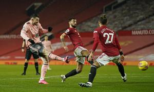 Oliver Burke's goal sealed a rare win at Old Trafford for Sheffield United (Tim Keeton/PA)