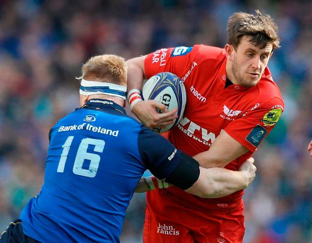 Leinster's James Tracy and Scarlets' Dan Jones. Photo: Lorraine O'Sullivan/PA Wire