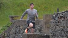 Rory McIlroy braves the elements while shooting a Nike advert in his home town