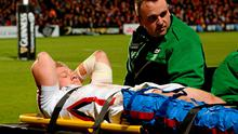 Stuart Olding, Ulster, being taken off the field with an injury early in the game