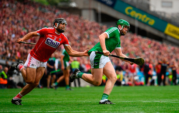 Shane Dowling of Limerick in action against Christopher Joyce of Cork. Photo by Ramsey Cardy/Sportsfile