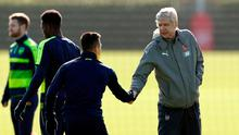 Arsene Wenger shakes hands with Arsenal's Alexis Sanchez during training
