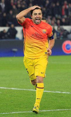 Barcelona's Xavi Hernandez celebrates after scoring a penalty against Paris St Germain during their Champions League quarter-final first leg soccer match at the Parc des Princes Stadium in Paris.
