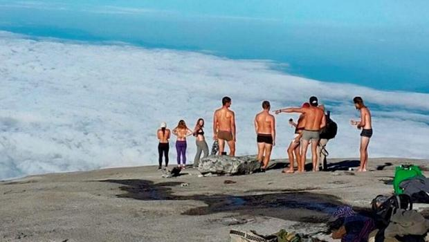 The moment a group of tourists undressed on top of Malaysian mountain