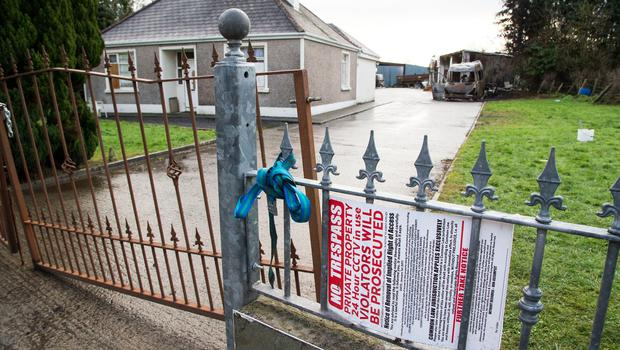 Controversy: Masked men attacked security guards at the repossessed home of Anthony McGann near Strokestown