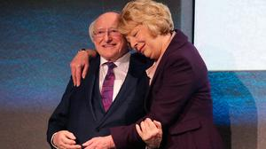 President Michael D Higgins is congratulated by his wife Sabina at Dublin Castle yesterday. Photo: Damien Eagers