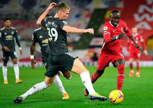 Manchester United's Scott McTominay tackles Sadio Mane. Photo: PA