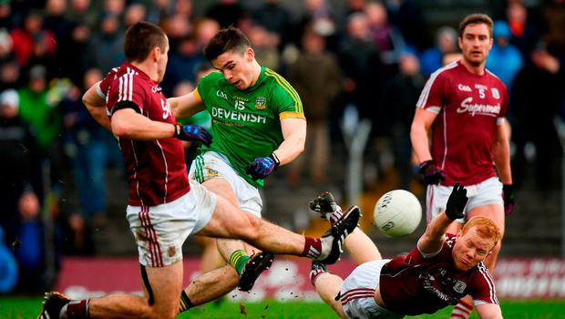 Donal Lenihan of Meath shoots to score his side's first goal of the game despite the tackle of Cathal Sweeney, left, and Declan Kyne of Galway during the Allianz Football League Division 2 Round 4 match between Meath and Galway at Páirc Tailteann in Navan, Co Meath. Photo by Ramsey Cardy/Sportsfile