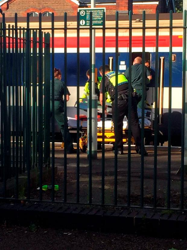 Emergency services at Wandsworth Common station after a man has died after leaning out of a train window and being hit by another train. Photo: @Lucie_Walker/PA Wire