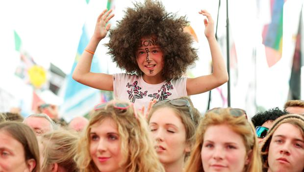 The crowd watching Lionel Richie performing on The Pyramid Stage during the Glastonbury Festival, at Worthy Farm in Somerset. PRESS ASSOCIATION Photo. Picture date: Sunday June 28, 2015. Photo credit should read: Yui Mok/PA Wire