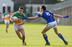 Niall McNamee, Offaly, in action against Barry Gilleran, Longford. Leinster GAA Football Senior Championship, Round 1, Offaly v Longford, O'Connor Park, Tullamore (Ray McManus / SPORTSFILE)