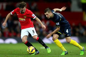 MANCHESTER, ENGLAND - JANUARY 11:  Juan Mata of Manchester United battles for the ball with Morgan Schneiderlin of Southampton during the Barclays Premier League match between Manchester United and Southampton at Old Trafford on January 11, 2015 in Manchester, England.  (Photo by Clive Mason/Getty Images)