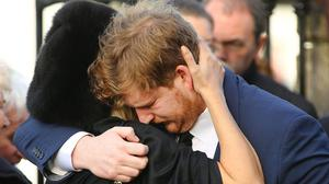 Mourning: Marian's son Jack comforted by his wife Jennifer. Photo: Gerry Mooney