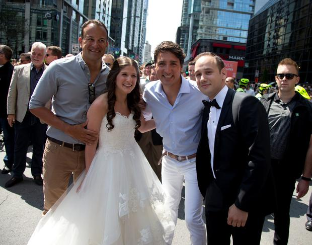 Varadkar and Trudeau pose with a bride and groom at the Montreal Pride parade in Montreal