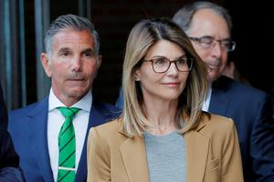 Actor Lori Loughlin, and her husband, fashion designer Mossimo Giannulli. Photo: Brian Snyder/Reuters