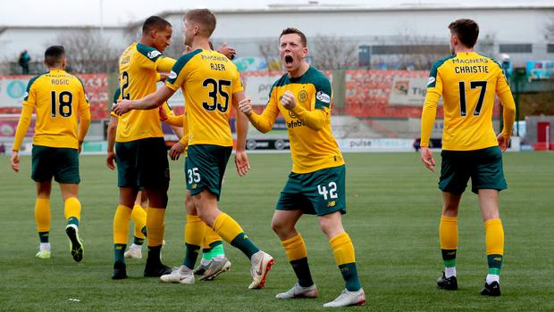 Celtic's Callum McGregor (second right) celebrates Christopher Jullien scoring their side's second goal during the Scottish Premiership match at the Fountain of Youth Stadium, Hamilton.