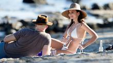 Emily Ratajkowski sunbathes at Paradise Cove in Malibu with boyfriend Jeff Magid. Picture: Splash News
