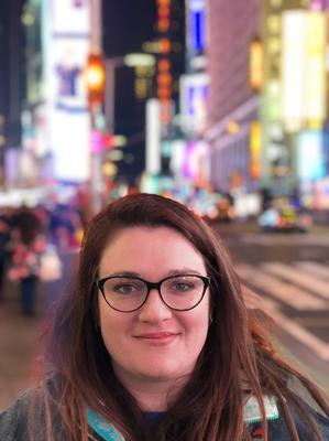 Rachel White in Times Square, New York, before the pandemic