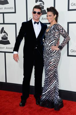 Recording Artist Robin Thicke (L) and actress Paula Patton attend the 56th GRAMMY Awards at Staples Center on January 26, 2014 in Los Angeles, California.  (Photo by Jason Merritt/Getty Images)
