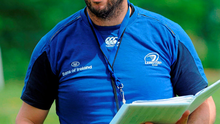 Michael Cheika looking through his notes during a Leinster training session in 2010