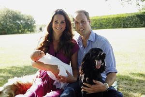 In this handout image provided by Kensington Palace, Catherine, Duchess of Cambridge and Prince William, Duke of Cambridge pose for a photograph with their son, Prince George Alexander Louis of Cambridge, surrounded by Lupo, the couple's cocker spaniel, and Tilly the retriever (a Middleton family pet) in the garden of the Middleton family home in August 2013
