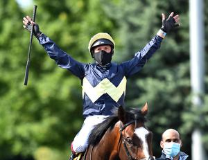 MASKED CRUSADER: Frankie Dettori wears a protective face mask as he celebrates winning on Galsworthy at Kempton Park in Sunbury-on-Thames yesterday. Photo: Hugh Routledge/Pool via REUTERS