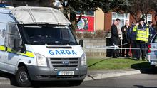 Gardai at the scene of this morning's shooting on Holywell Avenue