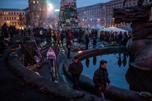 People visit Independence Square for what has become a traditional Sunday gathering to protest the government on February 23, 2014 in Kiev, Ukraine.