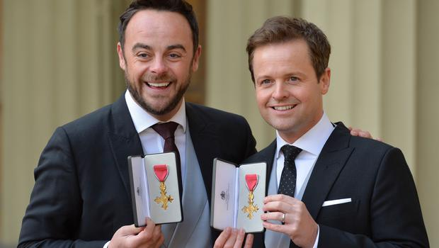 TV presenters Ant and Dec after they were presented with OBEs by the Prince of Wales (John Stillwell/PA)