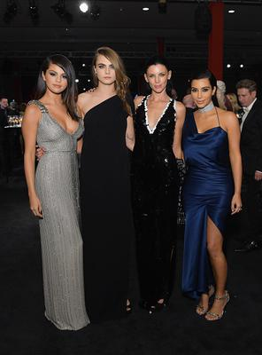 (L-R) Singer/actress Selena Gomez, wearing Gucci,, model Cara Delevingne, model Liberty Ross, and TV personality  Kim Kardashian West attend the 2014 LACMA Art + Film Gala honoring Barbara Kruger and Quentin Tarantino presented by Gucci at LACMA