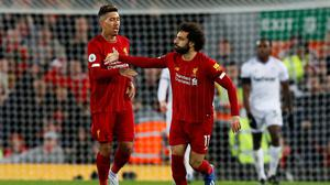 Liverpool's Mohamed Salah celebrates scoring their second goal against West Ham with Roberto Firmino
