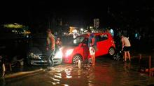 People try to move the cars from a flooded coastal road after an earthquake on the Greek island of Kos early Friday. A powerful earthquake struck Greek islands and Turkey's Aegean coast early Friday morning, damaging buildings and a port and killing people, authorities said. Photo: Kostoday.gr via AP